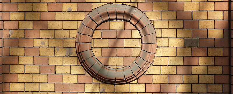 Brick faced prefabricated arches